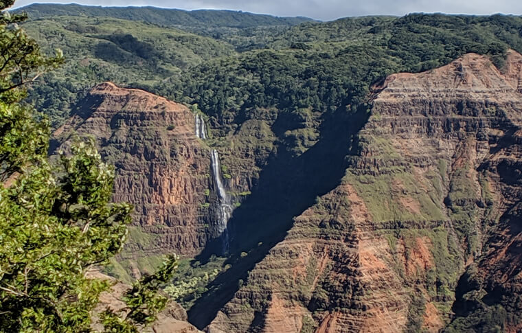 Picture overlooking the awesome canyon with a waterfall cascading down the side