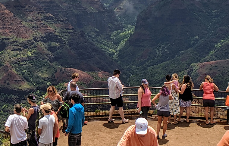People at a viewpoint overlooking the canyon