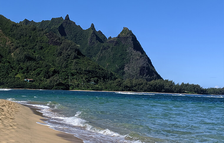 Pointy ridged mountain range next to the beach