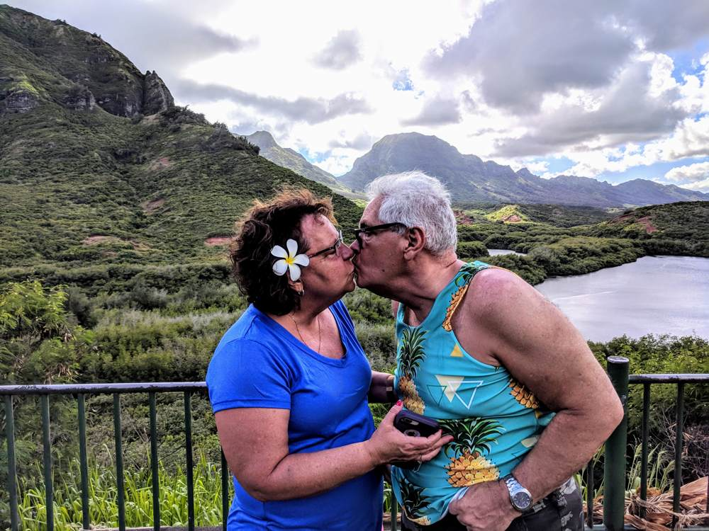Tourists honeymooners smooching Menhune ponds, Kauai